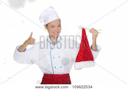 Contented Asian Chef In Christmas Cap With Chopsticks Under Snow