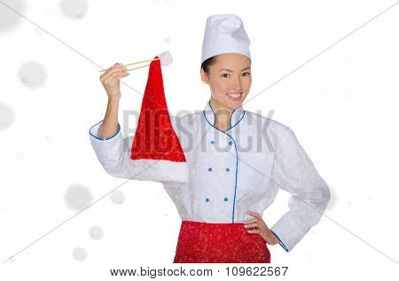 Happy Asian Chef In Christmas Cap With Chopsticks Under Snow