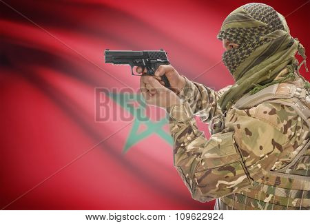 Male In Muslim Keffiyeh With Gun In Hand And National Flag On Background - Morocco