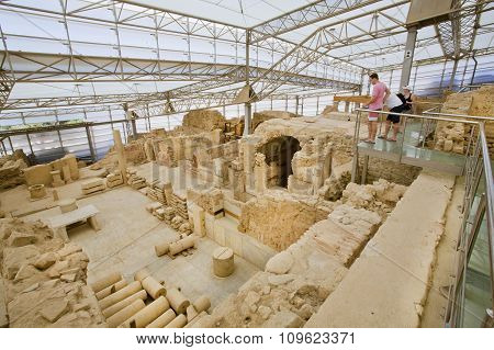 Tourists Watching Ephesus City Complex With Ruined Terraces From Roman Period