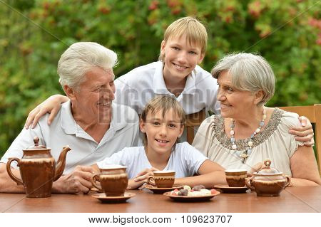 family drinking tea