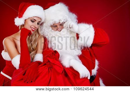 Santa Claus with a woman Christmas helper