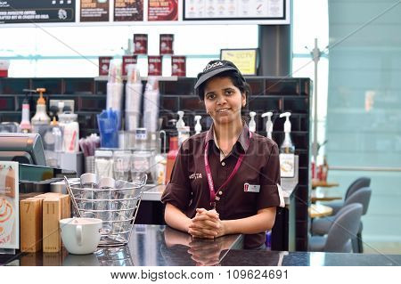 DUBAI, UAE - NOVEMBER 16, 2015: barista in Costa Coffee cafe in Dubai Airport. Dubai International Airport is the world's busiest airport by international passenger traffic.