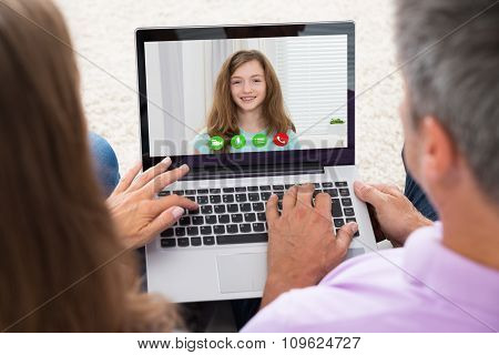 Couple Video Chatting On Laptop