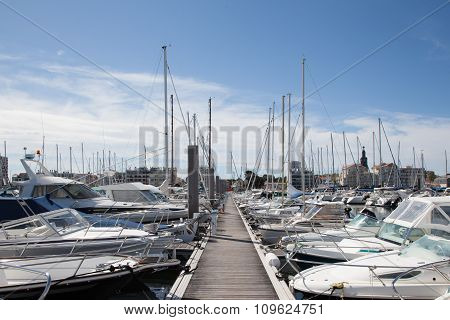 Yachts Parking In The Beautiful Harbour In France Against Blue Sky