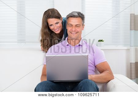 Mature Couple Looking At Laptop
