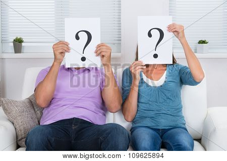 Couple Hiding Face With Question Mark Sign