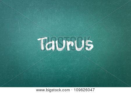 Green Blackboard Wall Texture With A Word Taurus