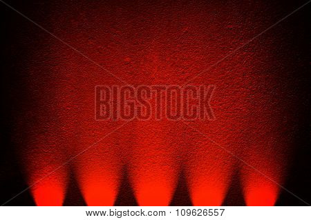 red wall with spotlight