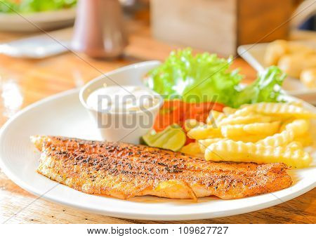 Fish Steak On Wooden Floor.
