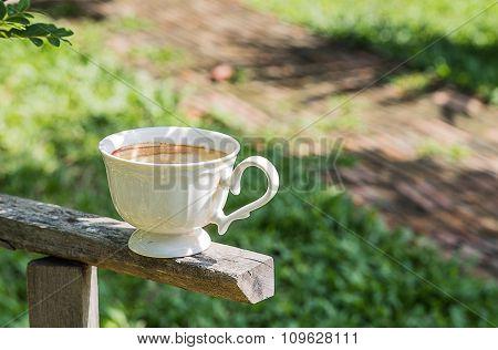 Coffee Mug On Green Background.