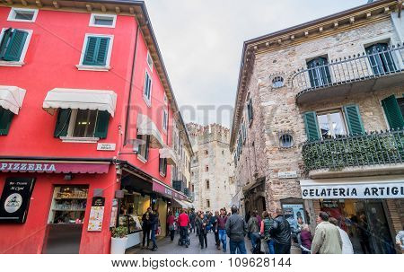 Street View With Shops And Tourists In Sirmione, Italy