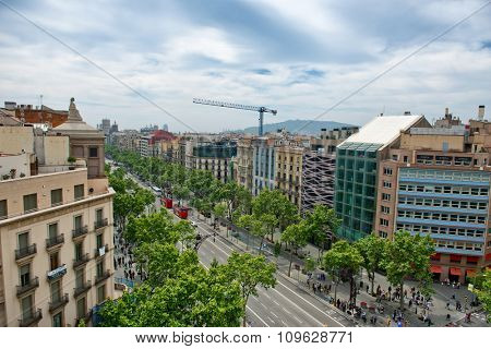 BARCELONA, SPAIN - MAY 01: Looking Down at Busy Street Intersection with Pedestrian Cross Walks, as seen from Casa Mila, Barcelona, Spain. May 01, 2015