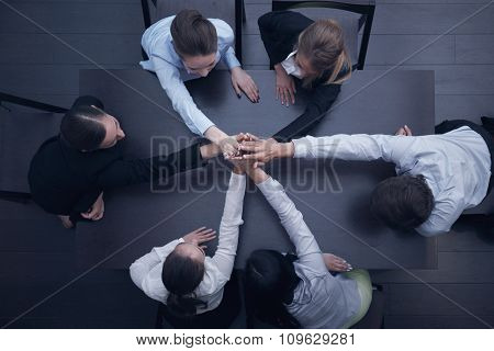 People With Their Hands Together
