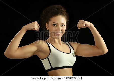 girl shows biceps