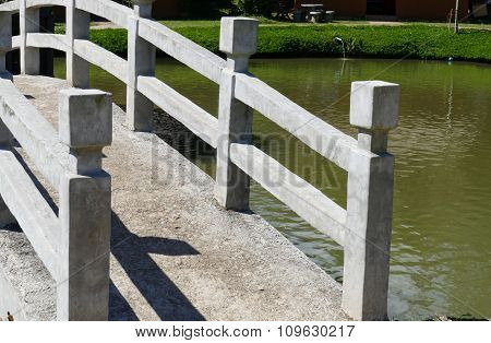 Cement Footbridge Across The Pond