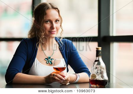 Young Woman With A Cognac.