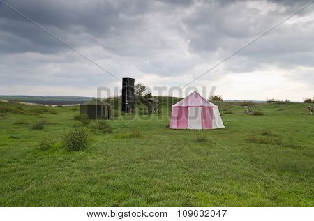 Dramatic Clouds And An Ancient Camp, Restored From Medieval Time