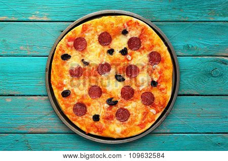 Cooked Salami Pizza On Turquoise Background