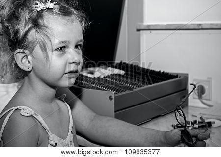 Eye Exam, Cute Little Girl Is Reviewing Eyesight.