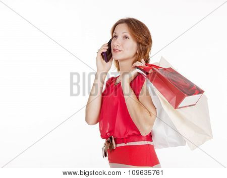 Girl With Gift Bags Speaks By Mobile Phone