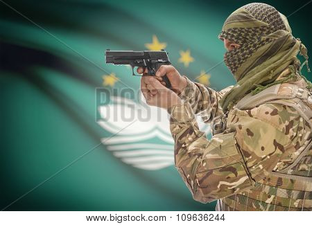 Male With Gun In Hand And National Flag On Background - Macau
