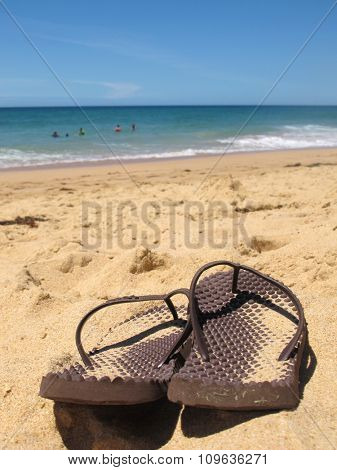 Close Up Flip Flops on Beach