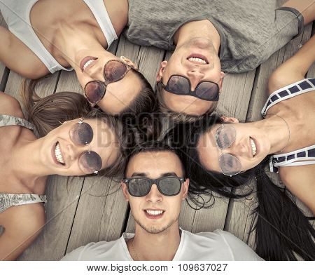Portrait of group friends on the wooden background.