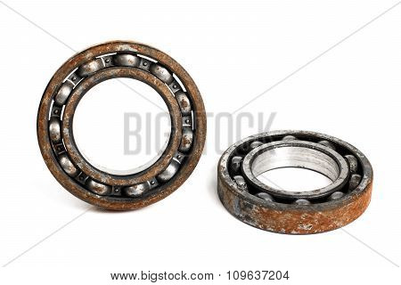 Old and rusty ball bearing, isolated on white background