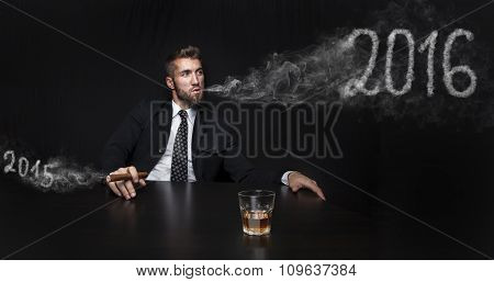 Businessman with cigar and drink