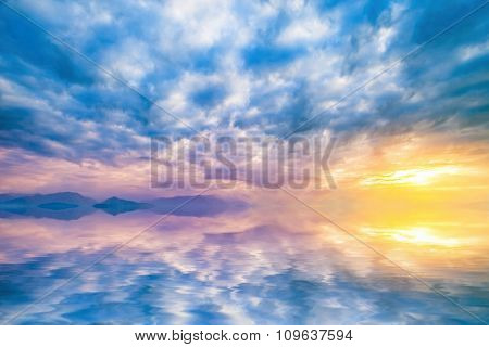 natural landscape with cloudy sky at sunset reflected in water
