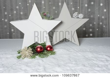Two Stars With Fir And Cones Standing In Snow