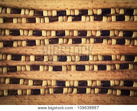 Retro Wooden Beads On A Wooden Board