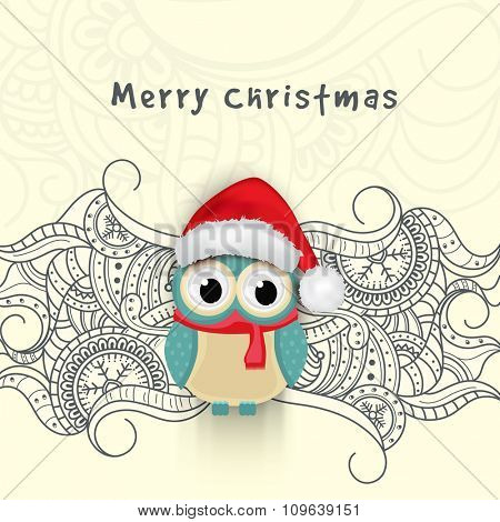 Creative floral design decorated greeting card with cute owl in Santa cap for Merry Christmas celebration.