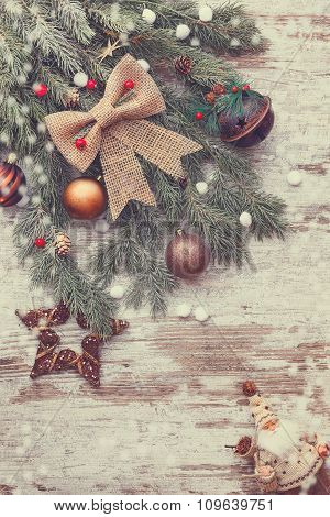 Beautiful Christmas wooden background with snow fir tree