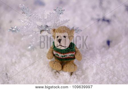 Toy Monkey Near Shiny Snowflake Close-up.