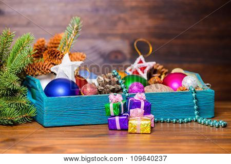 Composition Of Branch Fir Tree, Vintage Wooden Box With Christmas Decoration, Pinecones, Stars, Ball