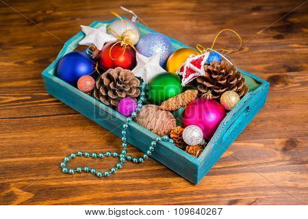 Vintage Wooden Box With Christmas Decoration, Tinsel,  Pinecones, Stars And Balls On Wooden Backgrou