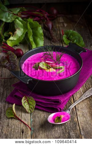 Beetroot Cream Soup On Rustic Background