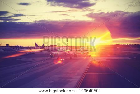 Vintage Filtered Picture Of Airport At Sunset, Travel Concept.