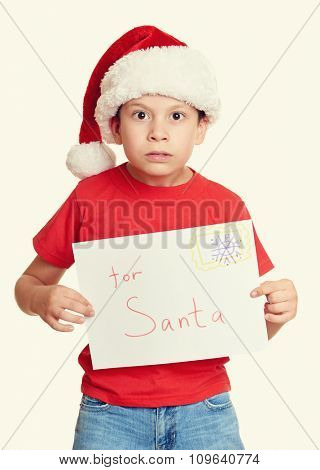 winter holiday christmas concept - boy in hat with letter to santa on white isolated