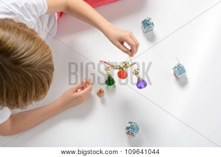 Girl Playing With Christmas Decorations