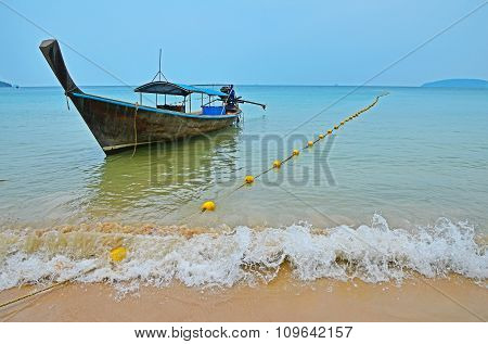 Traditional Thailand Old Long Tail Boat In Transparent Water