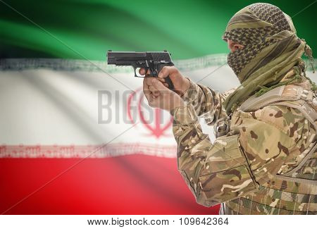 Male In Muslim Keffiyeh With Gun In Hand And National Flag On Background - Iran