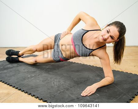 Woman Doing Side Elbow Plank
