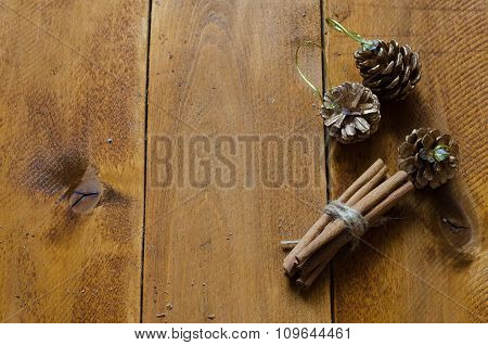 Some cinnamon sticks tied with a natural rope on wooden table.