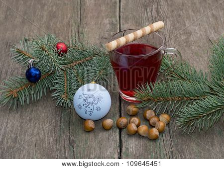 Coniferous Branch With Christmas Tree Decorations, Tea And Nutlets