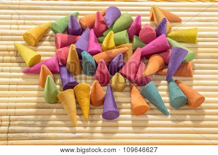 Colorful Incense Cones With Wooden Background
