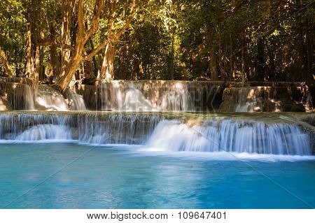 Beautiful blue stream water fall in deep forest national park