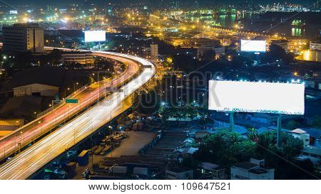 City highway overpass at night, aerial view